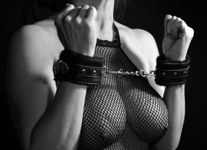 handcuffed BDSM girl's breasts