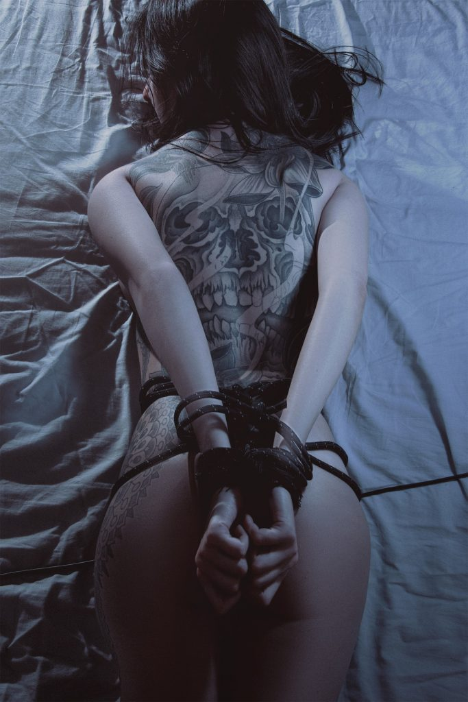 Girl tied naked in bed